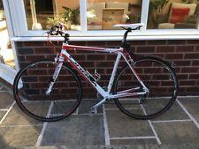 Orbea Aqua road bike, red and white 52cm frame with 24 inch wheels.
