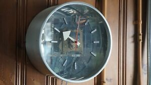 Pendulum Clock by Howard Miller Clock Co. designed by George Nelson