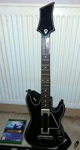 Guitar Hero Bundle Xbox One, guitar with strap, game and stick.