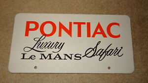 Vintage Pontiac Luxury Le Mans Safari dealer showroom license plate. 1973-73-74