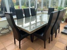 Leather high back dining chairs with removable covers, dark brown, upholstered.