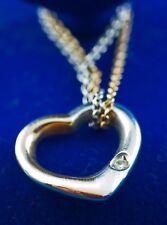 Swinging Heart von CHRIST mit Doppelkette, 750er Gelbgold/950er Platin