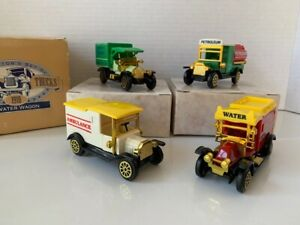 Collector's Set of Four Classic 1918 Trucks Water Wagon, Delivery Van, Ambulance