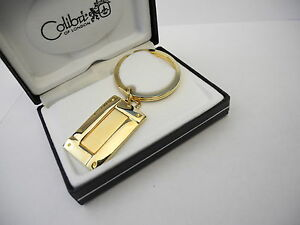 COLIBRI POLISHED GOLDTONE OVER AND UNDER SERIES  KEY RING NEW  REDUCED