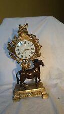 pendule aux cheval bronze  noircie et dorée  ancienne mécanisme  aux  coq