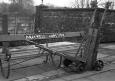 PHOTO  LMS LNWR HOLYWELL JUNCTION RAILWAY STATION SEAT AND TROLLEY IN 1961