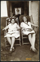 elegant girls reading in deck chair,  Vintage Photograph, 1920'