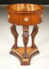Maitland Smith mahogany circular jardiniere with liner on carved lions. Lot 17