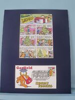 Garfield celebrates Christmas with Jon and Odie & First Day Cover of his stamp