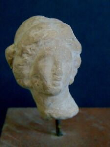 circa 325 B.C. HEAD FROM A TANAGRA FIGURINE