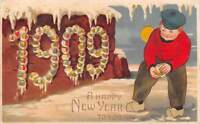 HOLD TO LIGHT NEW YEAR DATE POSTCARD FOR 1909, BOY MAKING A SNOWBALL used 1908
