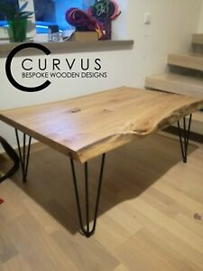 Solid oak  waney edged table with industrial legs