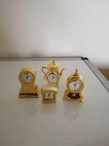 4 GILT METAL MINIATURE QUARTZ NOVELTY  MANTLE ETC CLOCKS