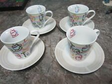 Four Piece Coffee Cup and Saucer Set