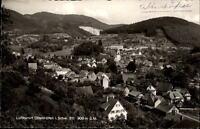 Ottenhöfen Schwarzwald Postkarte 1956 datiert Gesamtansicht mit Bergen und Wald
