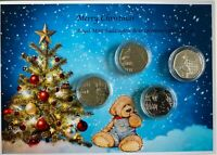 XMAS Paddington set of 4 mint uncirculated  50P commemorative coins .