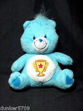 2004 CHAMP CARE BEAR IN SITTING POSITION 7 IN PLUSH TUSH TAG CARE BEAR BUTTON