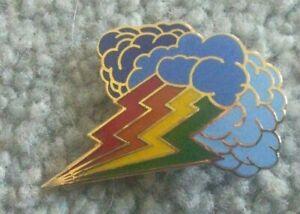 Rainbow coloured lightning and storm cloud badge
