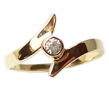 Yellow gold ring 18 kt. backwords women's with zircon crystal white