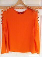 Akira orange blouse