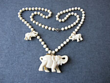 Vintage elephant dangles flower shaped beads creamy plastic necklace