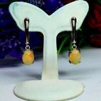 NATURAL 7 X 9 mm. OVAL WHITE RAINBOW OPAL EARRINGS 925 STERLING SILVER WHITE GP