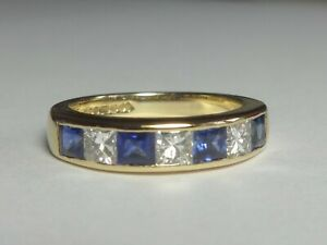 18CT YELLOW GOLD 4 FINE SAPPHIRE & 3 PRINCESS CUT DIAMOND HALF HOOP RING