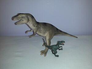 2x Toy Dinosaur Figurines - Tyrannosaurus Rex, Velociraptor