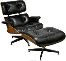A CHARLES AND RAY EAMES BLACK LEATHER LOUNGE CHAIR AND OTTOMAN FOR ... Lot 65854