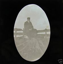 Glass Magic lantern slide MAN SMOKING A PIPE ON A TREE STUMP C1900