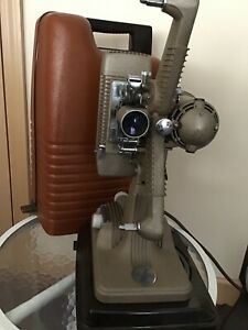REVERE 16MM PROJECTOR WITH CASE, SPLICER, CORD, REEL AND MANUAL