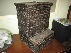 An old tramp art chip carved desktop chest of drawers