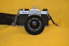 Pentax K1000 35mm SLR Film Camera with 28-80mm Sigma zoom lens and hood