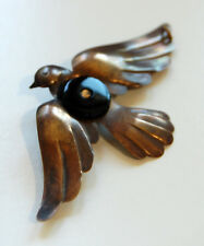 VINTAGE RAW BRASS BIRD SPARROW IN FLIGHT METAL STAMPING PENDANT w/ BLACK GLASS