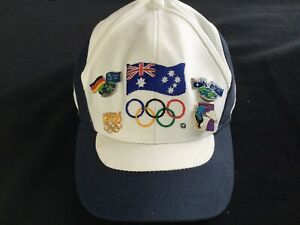 OFFICIAL SYDNEY OLYMPIC 2000 CAP WITH TEAM AUS ON BACK & FOUR GREAT BADGES/PINS