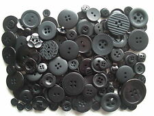 Black buttons mixed sizes 100 grams