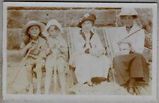 Edwardian era Postcard - Beautifully dressed ladies and children on the beach