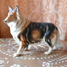 """Vintage Colly Dog Porcelain Figurine Sitting Stamped H691 Hand Painted 6""""L X 5.5"""
