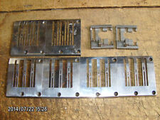 UNION SPECIAL 3-needle sewing machine lot (6) throat plates & (2) feed dogs