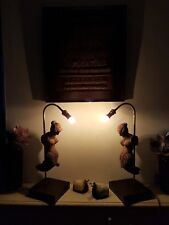 Pair of carved element table lamps