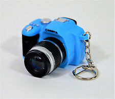 "SINGLE LENS REFLEX CAMERA KEYCHAIN BLUE & BLACK 1 1/4 INCHES H, 2"" W, 2"" D NEW"