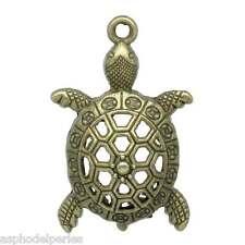 2 breloques tortue couleur bronze 39 x 25 mm