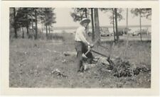 Man Cuts Logs with Buck Bow Wood Saw in Field Vintage Snapshot Tool Lumber