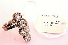4 White Topaz Stones: Womens Ring in Sterling Silver Setting. Size 6.5