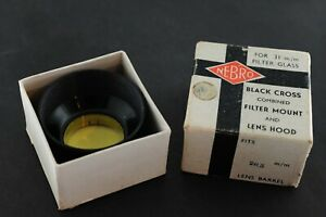 Vintage 1950s-60s Nebro lens hood and yellow filter for 28.5mm lens barrel.