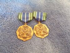 Two Military Achievement Medals