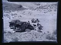 Vintage photo negative.Tailgate Party, Old Cars in California Desert c1950s .ct9