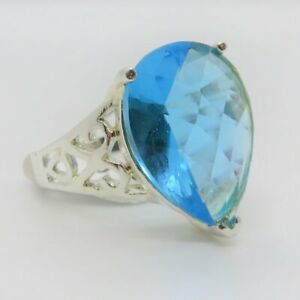 10kt white gold plated Topaz color Solitaire Crystal Swirl Ring size 8 as shown