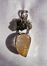 Moldavite and Rutile quartz pendant set in Sterling silver.