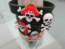 8 x VERY COOL BLACK RUBBER PIRATE BRACELETS.